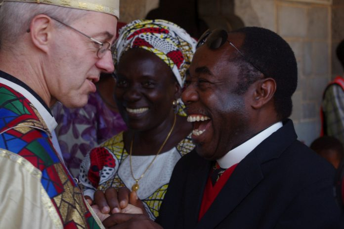 Ben and Gloria Kwashi greeting Justin Welby