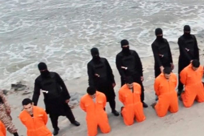 ISIS video still of beach murders.jpg